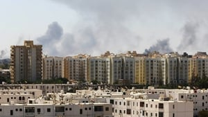 Militias have exchanged rocket and artillery fire for two weeks in southern Tripoli