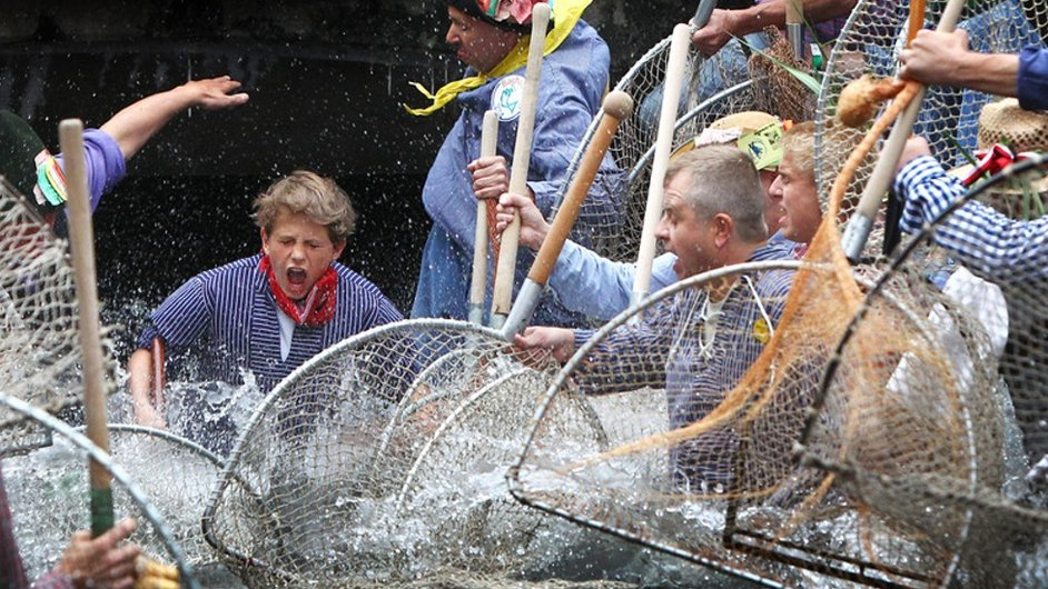 Fisher Day celebrants jump into the water with nets, at the river of Memmingen, Germany Pic: courtesy of EPA