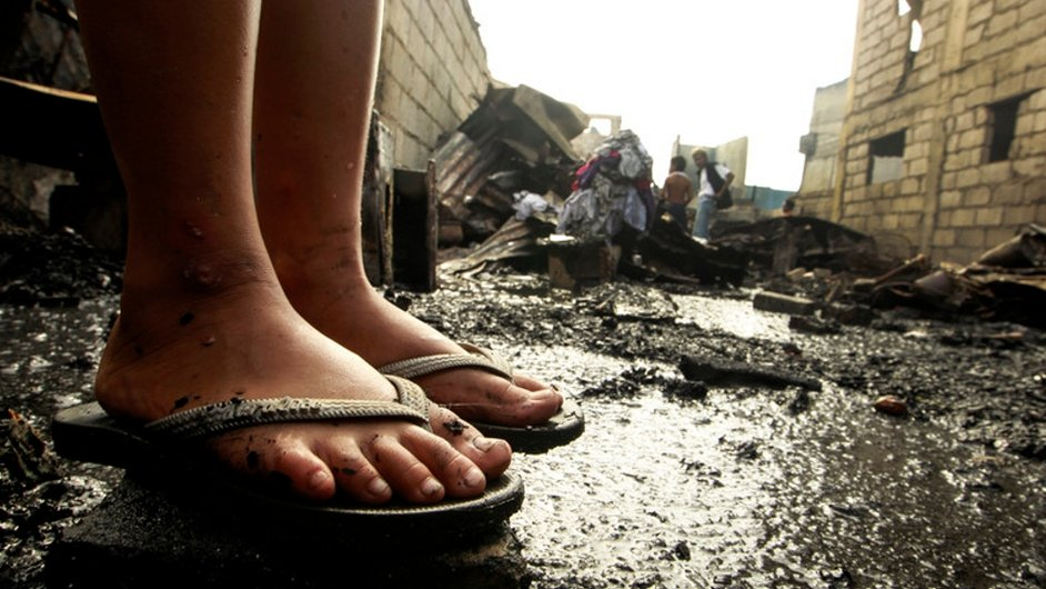Filipino residents peruse the wreckage after a fire in the Tondo slum area, in Manila, Philippines  Pic: courtesy of EPA
