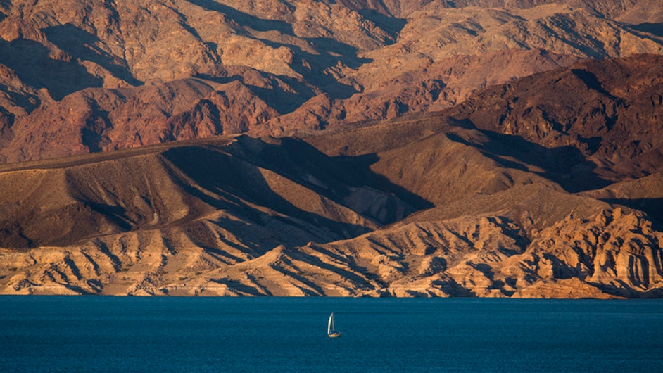 A boat cruises across Lake Mead, which is at its lowest level since it was filled in 1937 Pic: courtesy of EPA