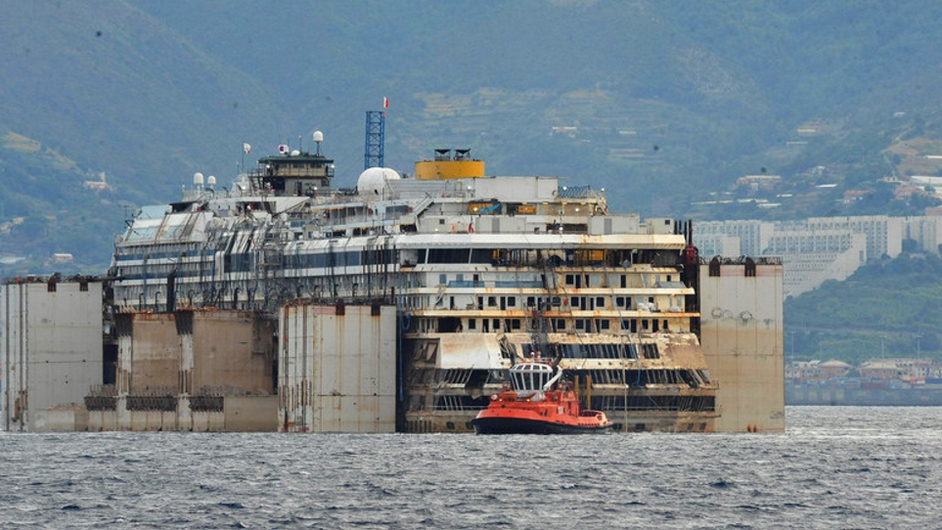 Costa Concordia has arrived in Genoa, where dismantling operations are predicted to last two years