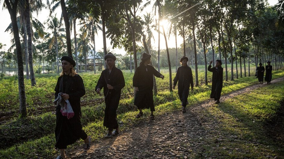 An-Nadzir walk to attend Eid Al Fitr mass prayer at Mawang Lake, Indonesia