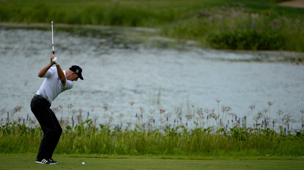Jim Furyk hits his approach to the 15th hole