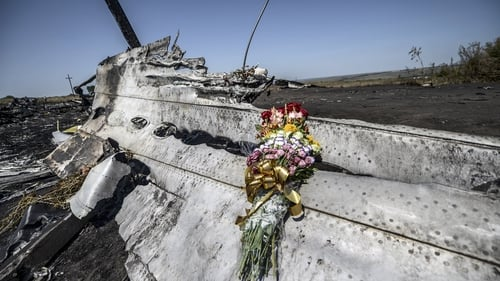 Flowers left at the site of the crash by family members of an Australian victim