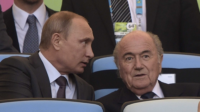 Russian President Vladimir Putin (L) and FIFA President Joseph Blatter at this summer's World Cup in Brazil