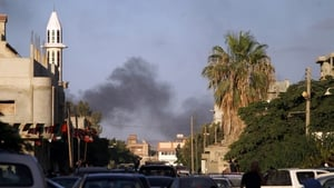 The clashes are between rival militia groups battling over the city's main airport