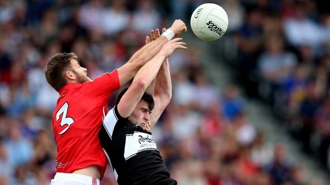 Cork's Eoin Cadogan and Pat Hughes of Sligo battle for the ball