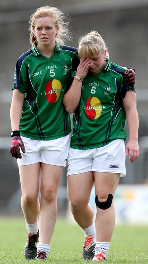 Corrigan and Barry leave the pitch after the game against Tyrone