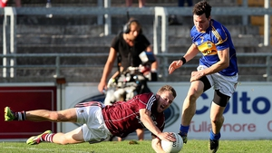 Michael Lundy of Galway with Ciaran McDonald of Tipp