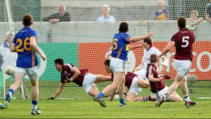 Tipperary's Colin O'Riordan navigates a sea of bodies to score his side's third goal