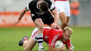 Sligo's Brian Curran and Michael Shields of Cork