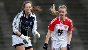 Tyrone's Cara McCrossan celebrates scoring as Kildare goalkeeper Becky McGuirk looks on dejected