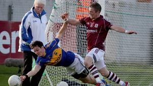 Ciaran McDonald of Tipp with Danny Cummins of Galway
