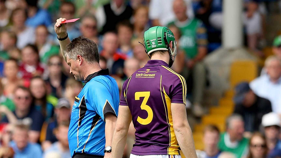 From bad to worse: referee Barry Kelly shows Matthew O'Hanlon a red card