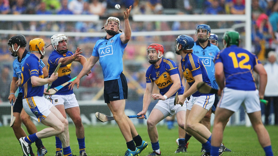 Dubin were under immense pressure from Tipp: Here, Liam Rushe attracts the attention of Lar Corbett, Patrick Maher, Denis Maher and Jason Forde