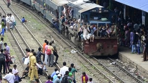 Bangladeshis cram onto a train as they rush home to their respective villages to be with their families ahead of the Muslim festival of Eid al-Fitr, in Dhaka