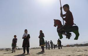 Afghan children enjoy a roundabout ride as they celebrate Eid al-Fitr in Kabul