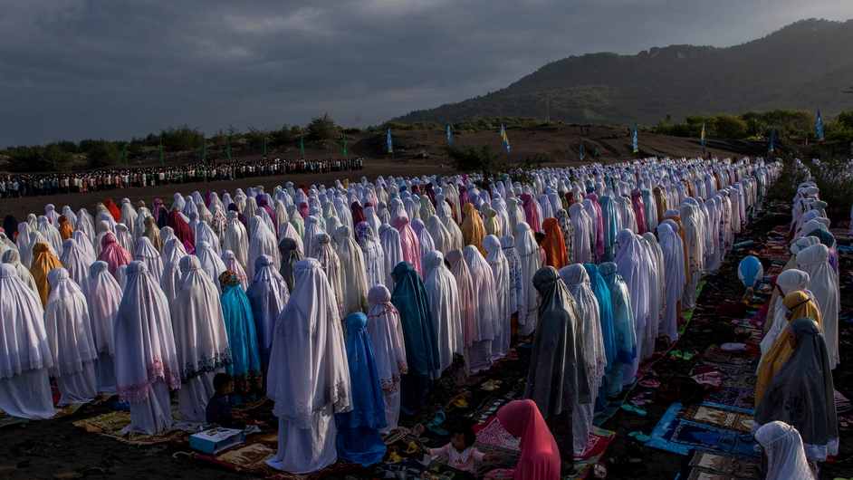 Indonesian Muslims perform Eid al-Fitr prayer on the 'sea of sands' at Parangkusumo beach in Yogyakarta