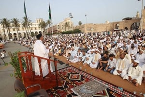 Libyan Muslims pray on the first day of Eid al-Fitr at the Martyrs' Square, in Tripoli