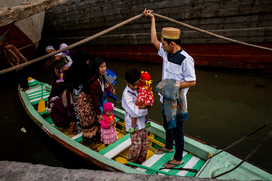 People arrive for the Eid al-Fitr festival at Sunda Kelapa Port in Jakarta, Indonesia