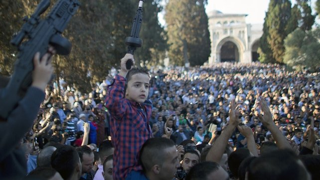 A Palestinian boy holds a plastic gun during a demonstration at the al-Aqsa mosque in Jerusalem