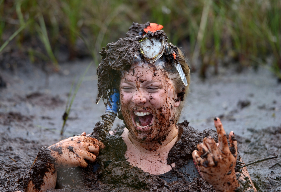 A woman enjoys the so-called Bog Jacuzzi at the Bog Snorkelling championship