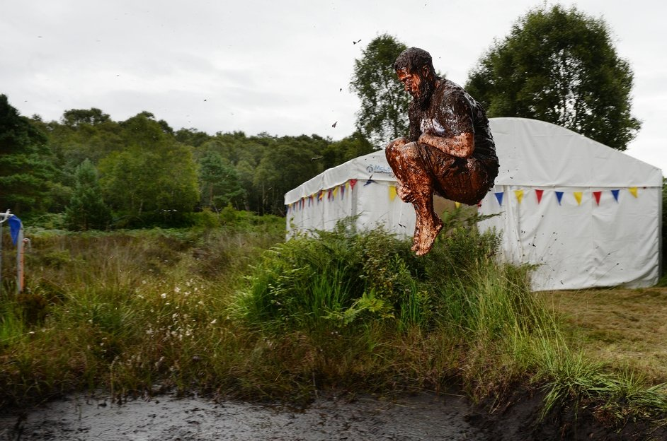 A man takes part in the Irish Bog Snorkelling championship in Dungannon to mark International Bog Day