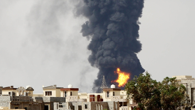 A huge fire erupted at an oil depot outside the Libyan capital today