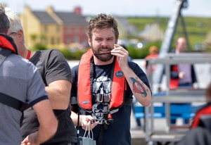 Nathan Hamill, son of actor Mark Hamill, arrives at Portmagee harbour to be transported to the set