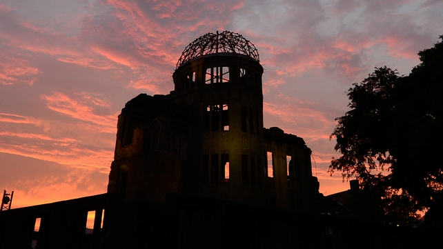 The Atomic Bomb Dome in silhouette during sunset over the Peace Memorial Park in Hiroshima