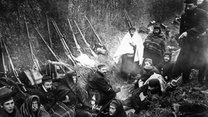 Belgian soldiers try to keep warm in the trenches on the Western Front