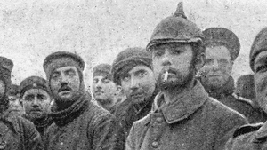 British and German troops make a Christmas truce in the trenches of the Western Front