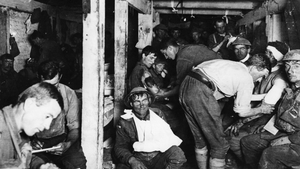 British soldiers relaxing and having wounds treated in an underground forward dressing station by the Menin Road