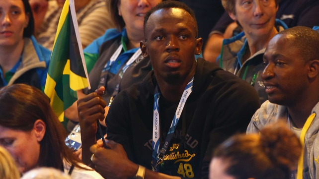 Usain Bolt watches on from the crowd during the preliminary round netball match between New Zealand and Jamaica