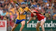 Clare talisman Shane O'Donnell evades the Rebels' Michael Collins on the way to scoring the opening goal in Ennis