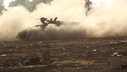 An Israeli Merkava tank rolls along the border between Israel and Hamas-controlled Gaza