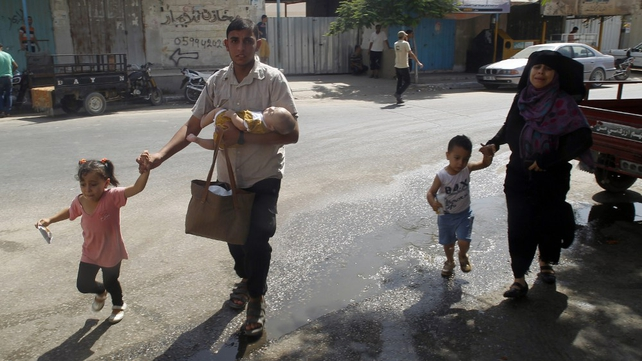 A Palestinian family flees their home in Rafah