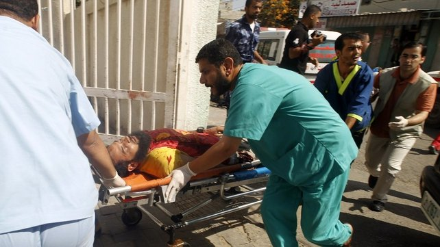 A wounded Palestinian man arrives at al-Najar hospital in southern Gaza