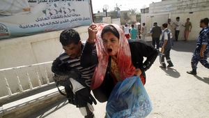 A wounded Palestinian woman arrives at al-Najar hospital in the south of Gaza this morning