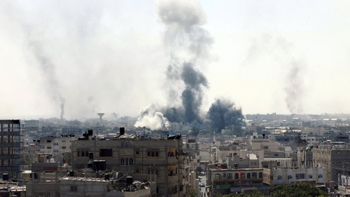 Smoke billows from buildings following an Israeli military strike east of Rafah this morning
