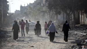 Palestinians who were displaced returning to check their homes in Gaza City's Shejaiya neighbourhood