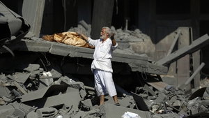 A man surveys the damage of what was once his home in northern Gaza