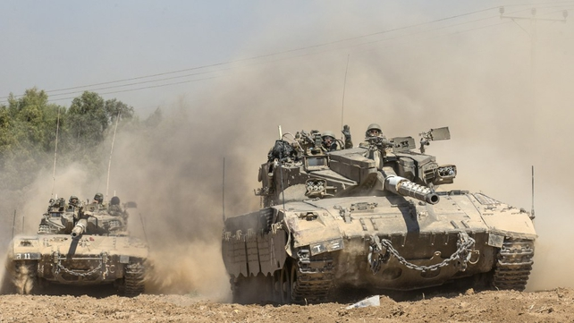An Israeli Merkava tank rolls to the southern Israeli border with the Gaza