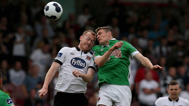 Chris Shileds of Dundalk and Cork's Garry Buckley challenge in the air