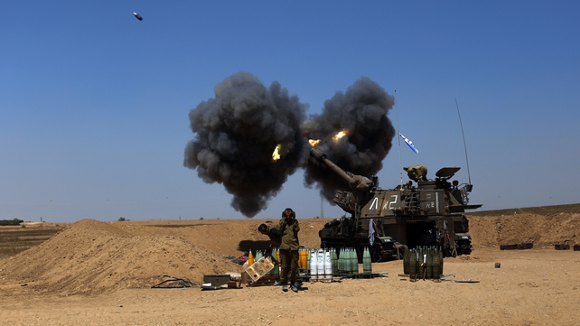 Israeli troops fire shells into Gaza