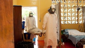 Kent Brantly (right) working at the clinic in Liberia