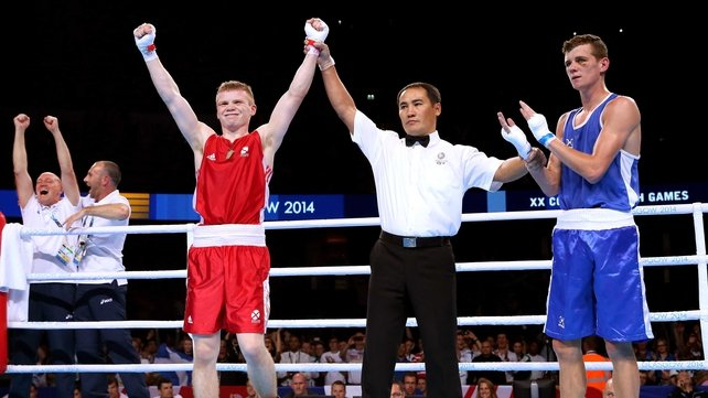 Charlie Flynn celebrates winning the lightweight gold medal against Joe Fitzpatrick