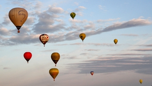 Hotair balloons fly over a field near Klaipeda, Lithuania