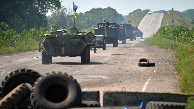 Ukrainian troops patrol near the eastern Ukrainian city of Debaltseve in the Luhansk region