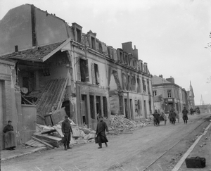Ruined shells of buildings on a French street during World War I